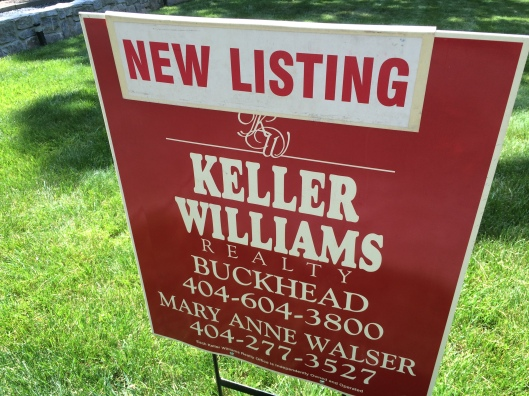 new-listing-yard-sign-close-up